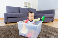 Asian baby boy playing toy at living room Stock Image