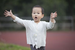 Asian baby boy running in the school Stock Images
