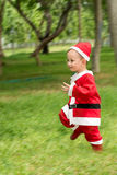 Asian baby boy in santa claus suit Stock Photo