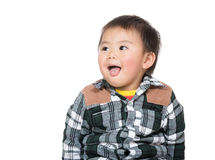 Asian baby boy showing tongue Royalty Free Stock Photography