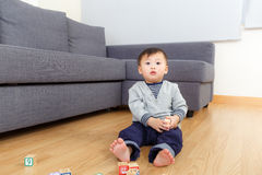 Asian baby boy sitting on floor and playing toy block Royalty Free Stock Images
