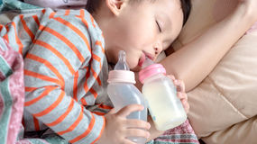 Asian baby boy sleeping in mother arm stock photos