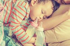 Asian baby boy sleeping in mother arm Stock Photography