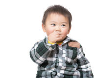 Asian baby boy suck finger Royalty Free Stock Photo