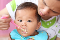 Asian baby boy to eating food in concept of health foods and nut Stock Photo
