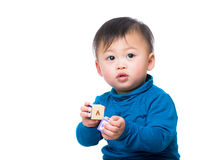 Asian baby boy with toy Royalty Free Stock Image