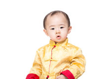 b11059504 Asian baby boy with traditional chinese costume. Isolated on white royalty  free stock photo