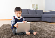 Asian baby boy using tablet Stock Images