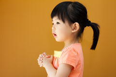 Asian baby child girl is praying. Portrait of a little Asian baby child girl is praying Royalty Free Stock Photography