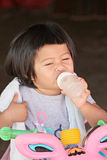 Asian baby child girl are Sucking Baby Bottle. Stock Images