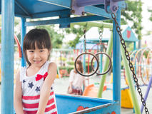 Asian baby child playing on playground Royalty Free Stock Images