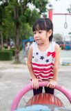 Asian baby child playing on playground Stock Image