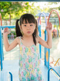 Asian baby child playing on playground, in sunset light Stock Photo