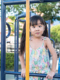 Asian baby child playing on playground, surprise action Royalty Free Stock Images