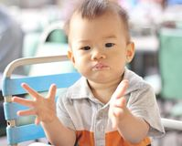 Asian baby clapping Royalty Free Stock Image
