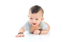Asian baby. Crawling beautiful baby boy playing on the floor royalty free stock image