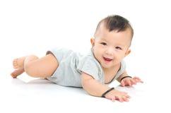Asian baby. Crawling beautiful baby boy smiling royalty free stock photo