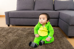 Asian Baby with dinosaur halloween party costume Royalty Free Stock Images