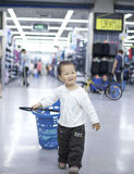 Asian baby dragn the shopping center Royalty Free Stock Photography