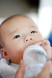 Asian baby is drinking milk Stock Photo