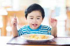 Asian baby eating a breakfast stock image