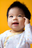 Asian baby girl. Portrait of a little Asian baby girl with isolated background Stock Photography
