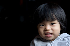 Asian baby girl. Portrait of little baby girl in jacket  in dark background Stock Photography