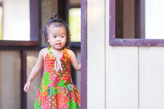 Asian baby girl behind the door Stock Image