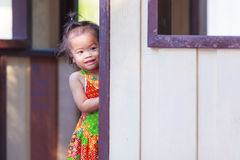 Asian baby girl behind the door Stock Photos