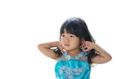 Asian baby girl in blue dress, isolated on white background. Royalty Free Stock Photos