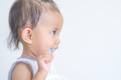Asian baby girl brushing her teeth Royalty Free Stock Photography