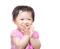 Asian baby girl clapping hand Royalty Free Stock Image