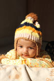 Asian baby girl in colorful winter cap Royalty Free Stock Image