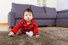 Asian baby girl creeping on carpet Stock Images