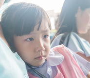 Asian baby girl cry. On her mother breasts Stock Images