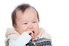 Asian baby girl crying and suck finger into mouth Stock Image