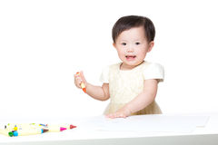 Asian baby girl drawing picture. Isolated on white Royalty Free Stock Images