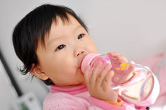 A Asian baby girl drinking water stock photo