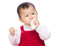 Asian baby girl eating biscuit Royalty Free Stock Photos