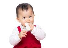 Asian baby girl eating biscuit Royalty Free Stock Photo