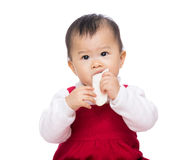 Asian baby girl eating biscuit Royalty Free Stock Images