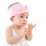 Asian baby girl eating Stock Photo
