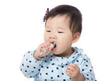 Asian baby girl eating snack Stock Photography