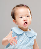 Asian baby girl eating snack Stock Photo