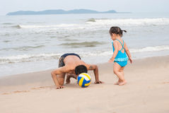 Asian baby girl and father playing football on the beach.Thailan Royalty Free Stock Photography