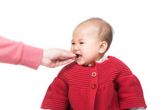 Asian baby girl feeding with snack Royalty Free Stock Images