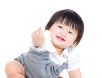 Asian baby girl finger pointing toward front. Isolated on white Royalty Free Stock Photo