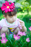 Asian baby girl with flower Royalty Free Stock Images