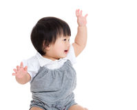 Asian baby girl greeting with hand up Stock Photo