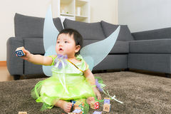 Asian baby girl with halloween party dressing and play toy block Royalty Free Stock Images